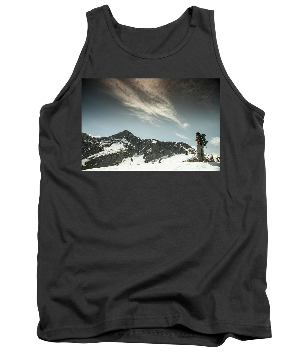 20-29 Years Tank Top featuring the photograph A Backpacker Gazes Up At Needle Peak by Christopher Kimmel