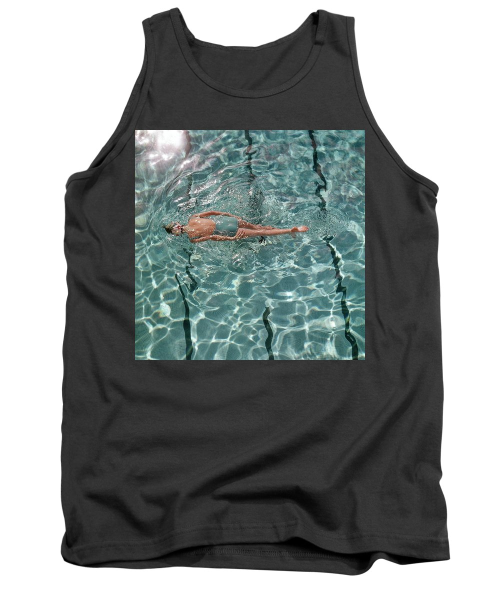 Water Tank Top featuring the photograph A Woman Swimming In A Pool by Fred Lyon