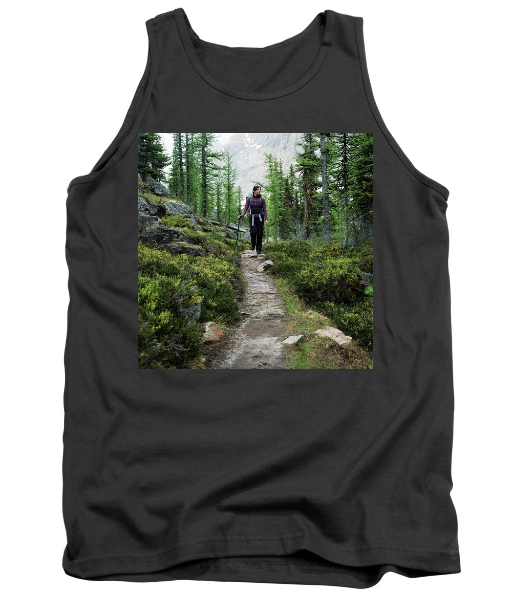 30-34 Years Tank Top featuring the photograph A Young Woman Walks Along An Sub-alpine by Andrew Querner
