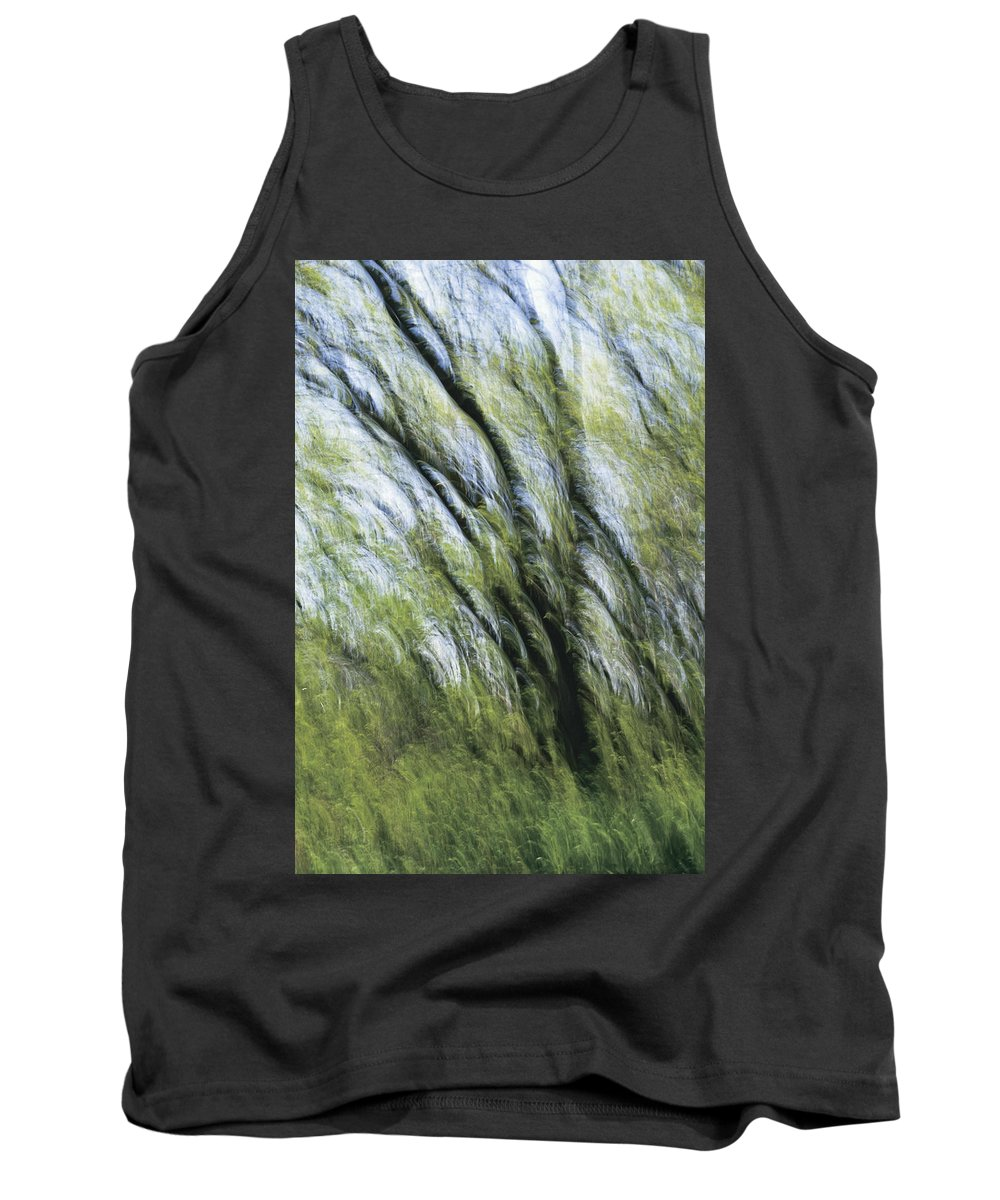 Blur Tank Top featuring the photograph Blurred Trees by Perry Mastrovito