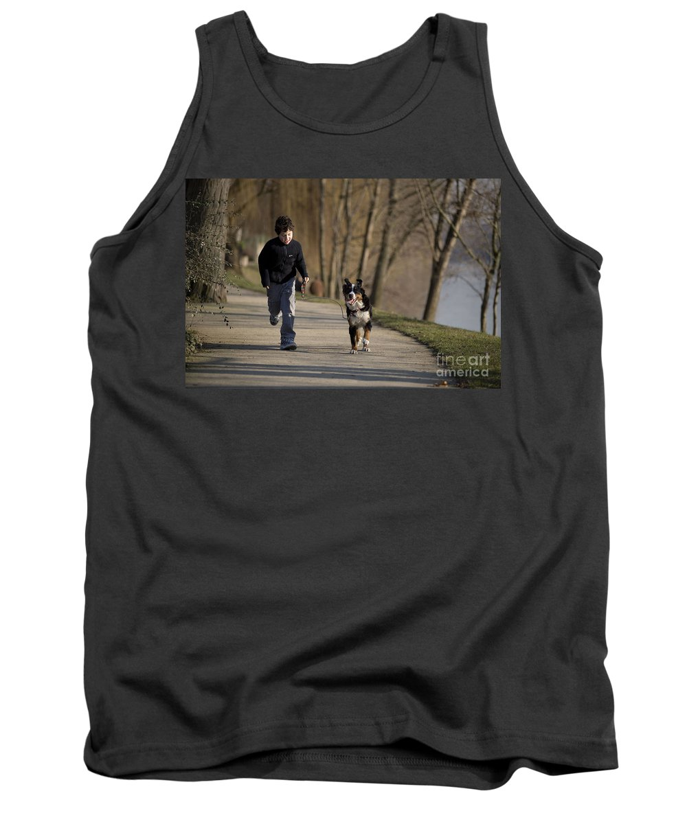 Bernese Mountain Dog Tank Top featuring the photograph Boy Running With Dog by Jean-Michel Labat