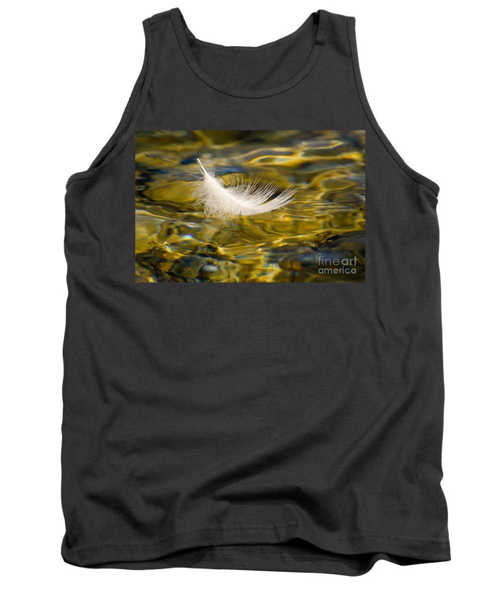 Feather Tank Top featuring the photograph Feather On Golden Water by Mats Silvan