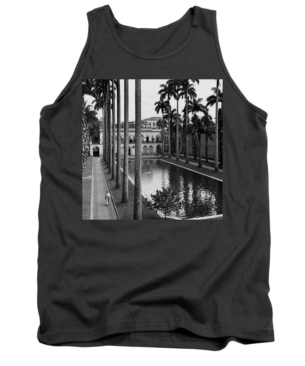 Exterior Tank Top featuring the photograph Palm Trees Bordering A Pool by Luis Lemus