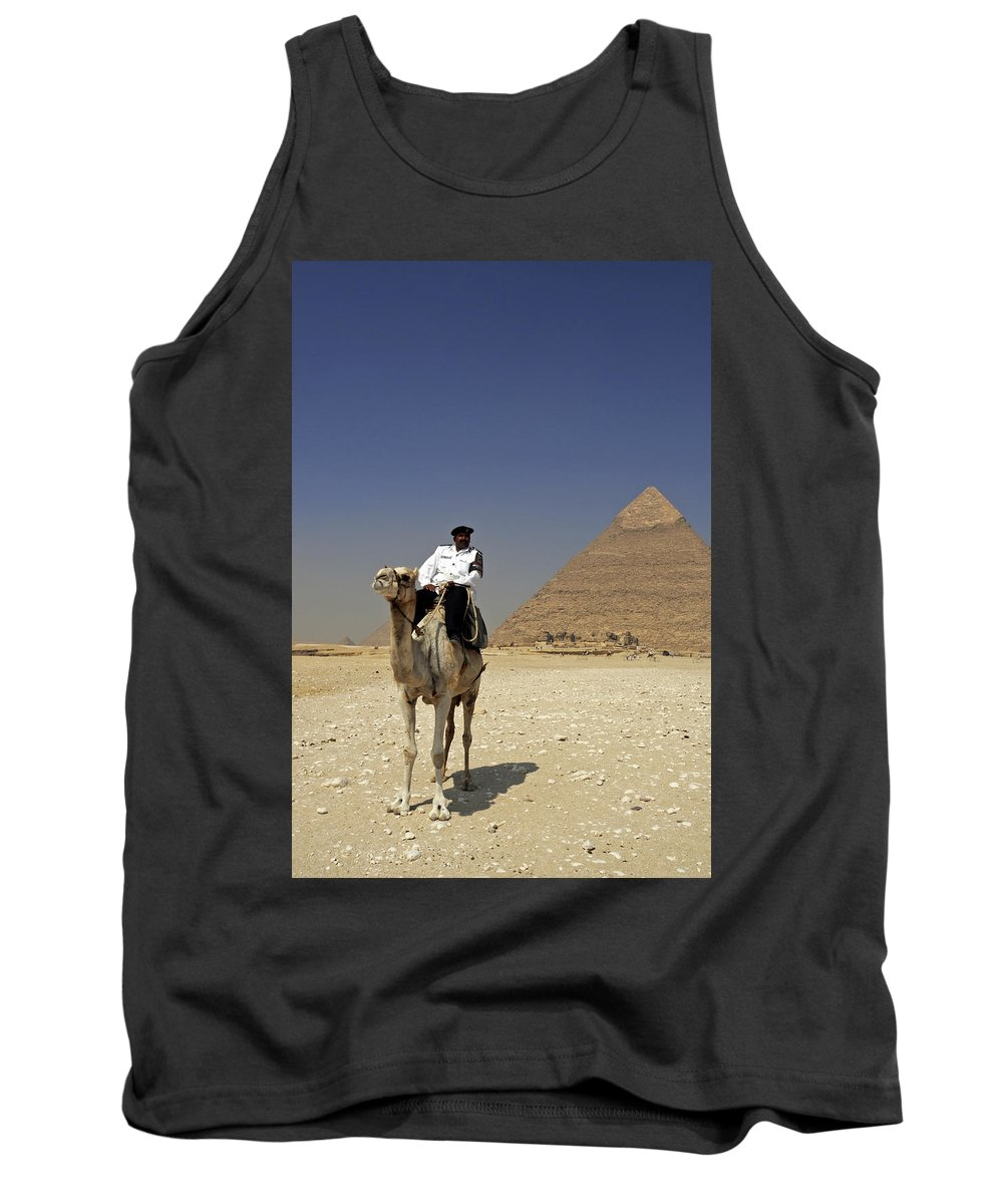 Police Officer Tank Top featuring the photograph Police Officer On A Camel In Front Of Pyramid In Cairo Egypt by Dray Van Beeck