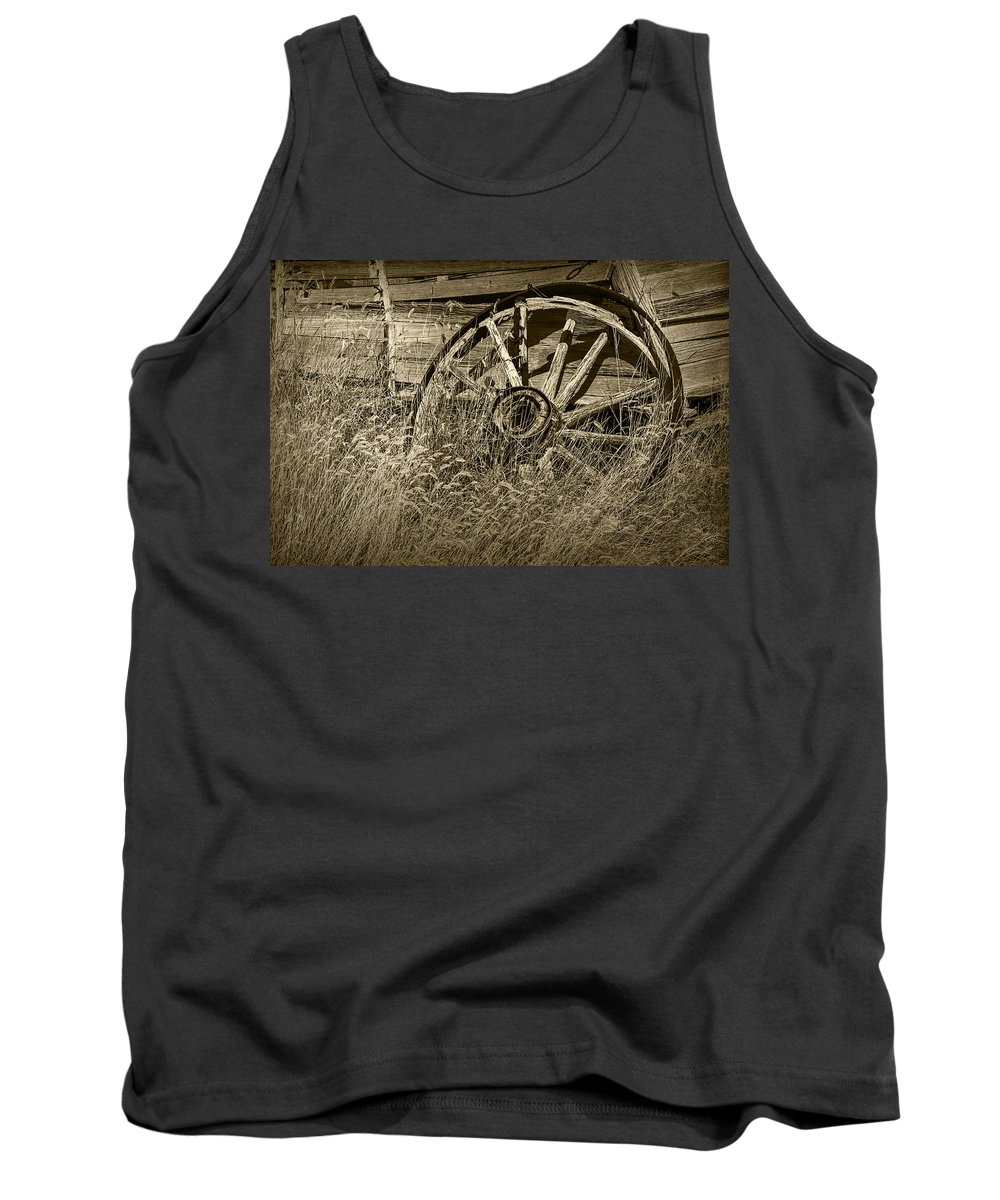 Art Tank Top featuring the photograph Sepia Toned Photo Of An Old Broken Wheel Of A Farm Wagon by Randall Nyhof