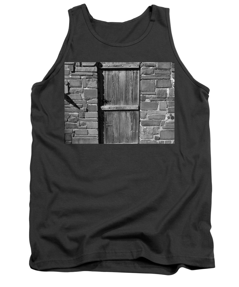 Black And White Tank Top featuring the photograph Wooden Door And Stone Wall 1 by Denise Mazzocco