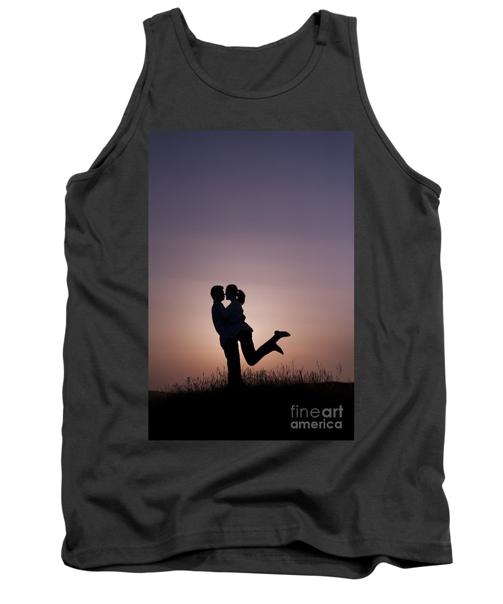 Couple Tank Top featuring the photograph Young Lovers Embracing At Sunset by Lee Avison