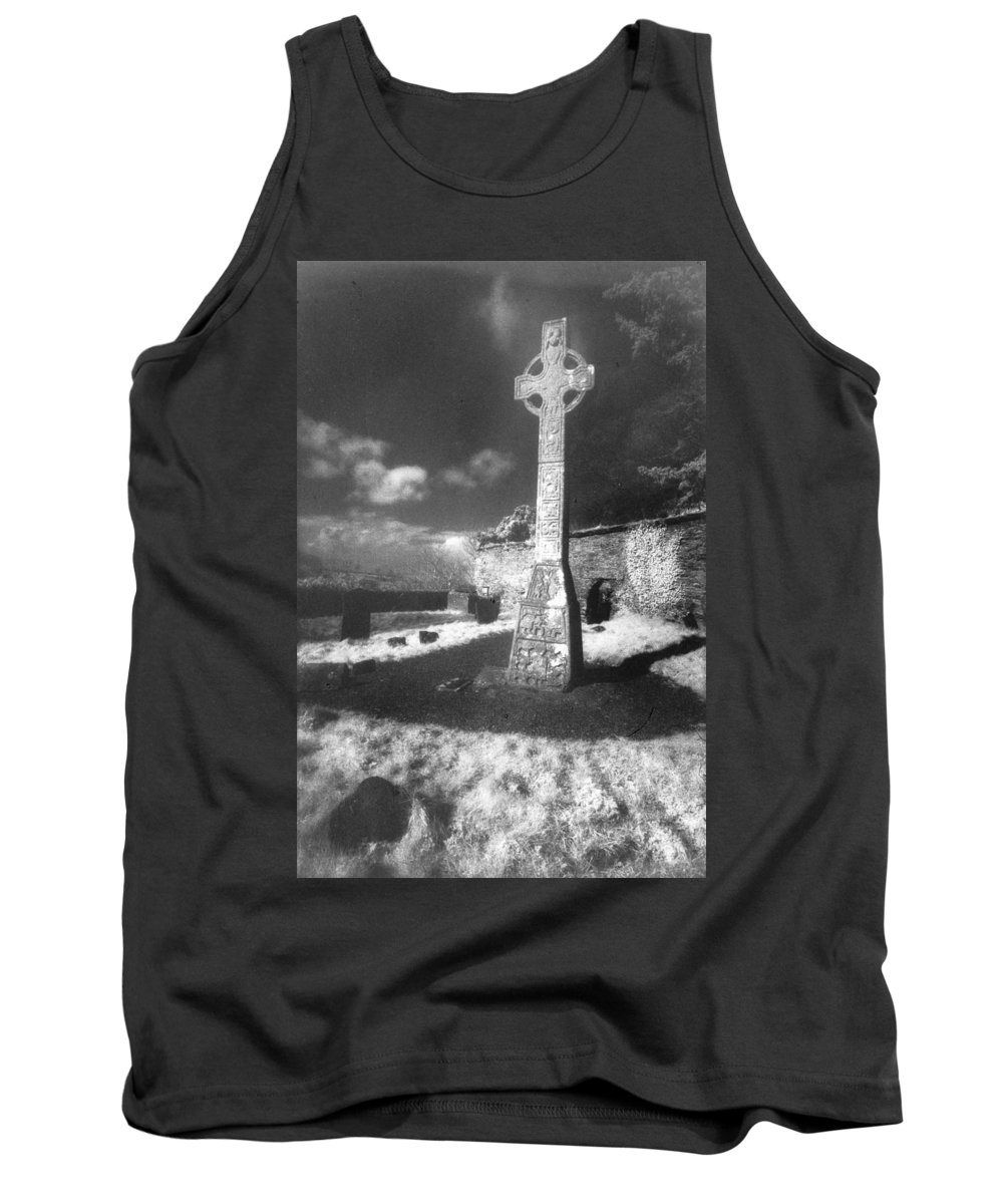 Monument; Stone; Carving; Carved; Shadows; Shadow; Irish; Landscape; Churchyard; Graveyard; Tombstones; Gravestones; Graves; Celtic; Eerie; Atmospheric; Misty; Mist; Solitary Tank Top featuring the photograph High Cross by Simon Marsden