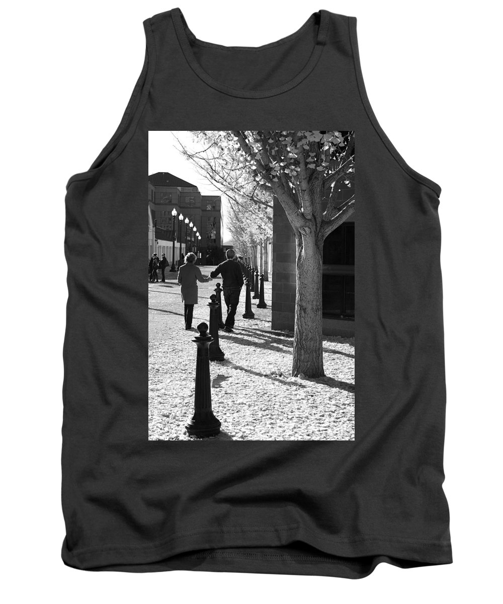 Couple Tank Top featuring the photograph A Couple Walking Together Holding Hands Downtown Asheville by Gray Artus