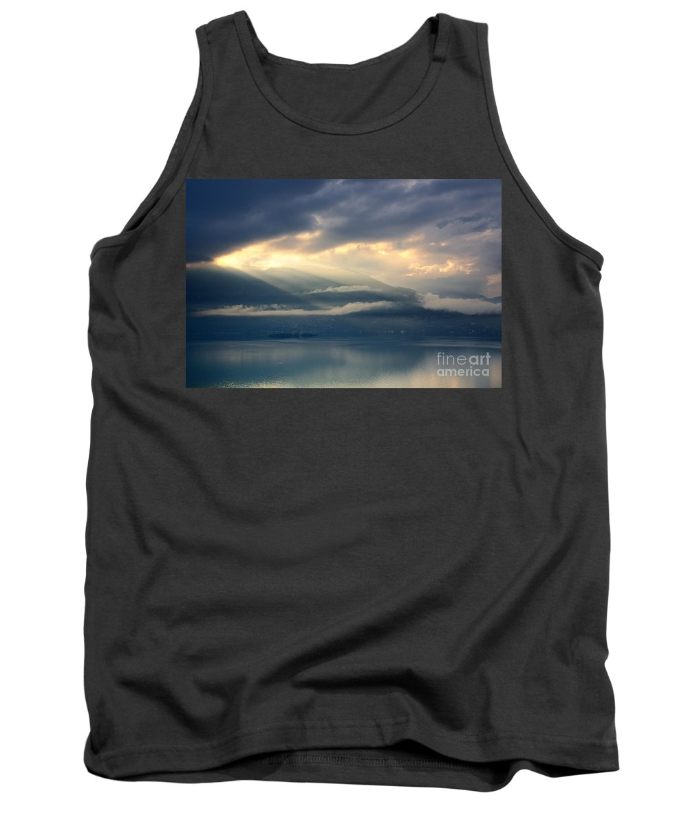 Sunlight Tank Top featuring the photograph Sunlight And Clouds Over An Alpine Lake by Mats Silvan