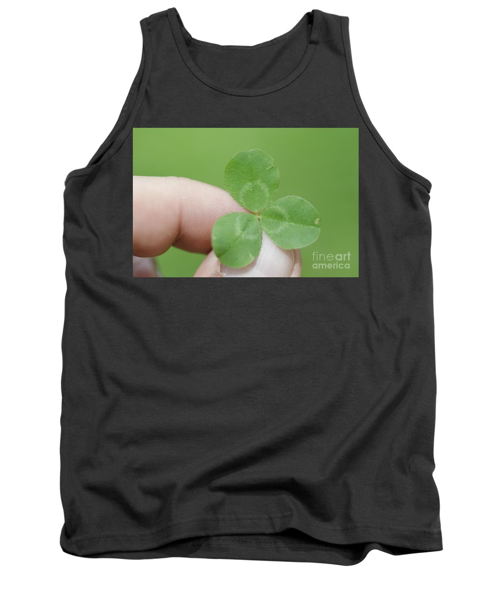 Three Leaf Clover Tank Top featuring the photograph Three Leaf Clover In A Hand by Mats Silvan