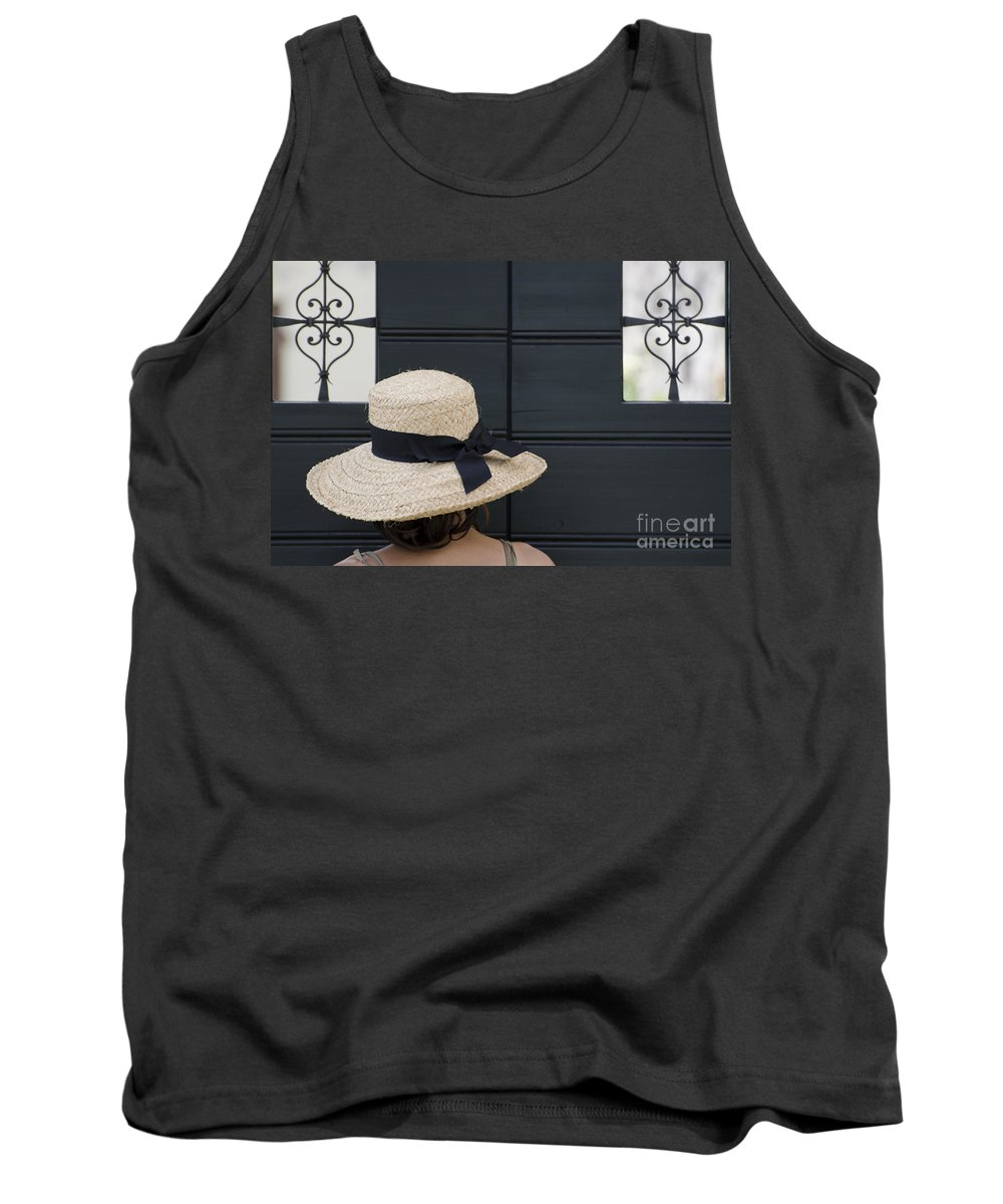 Woman Tank Top featuring the photograph Woman With A Straw Hat by Mats Silvan