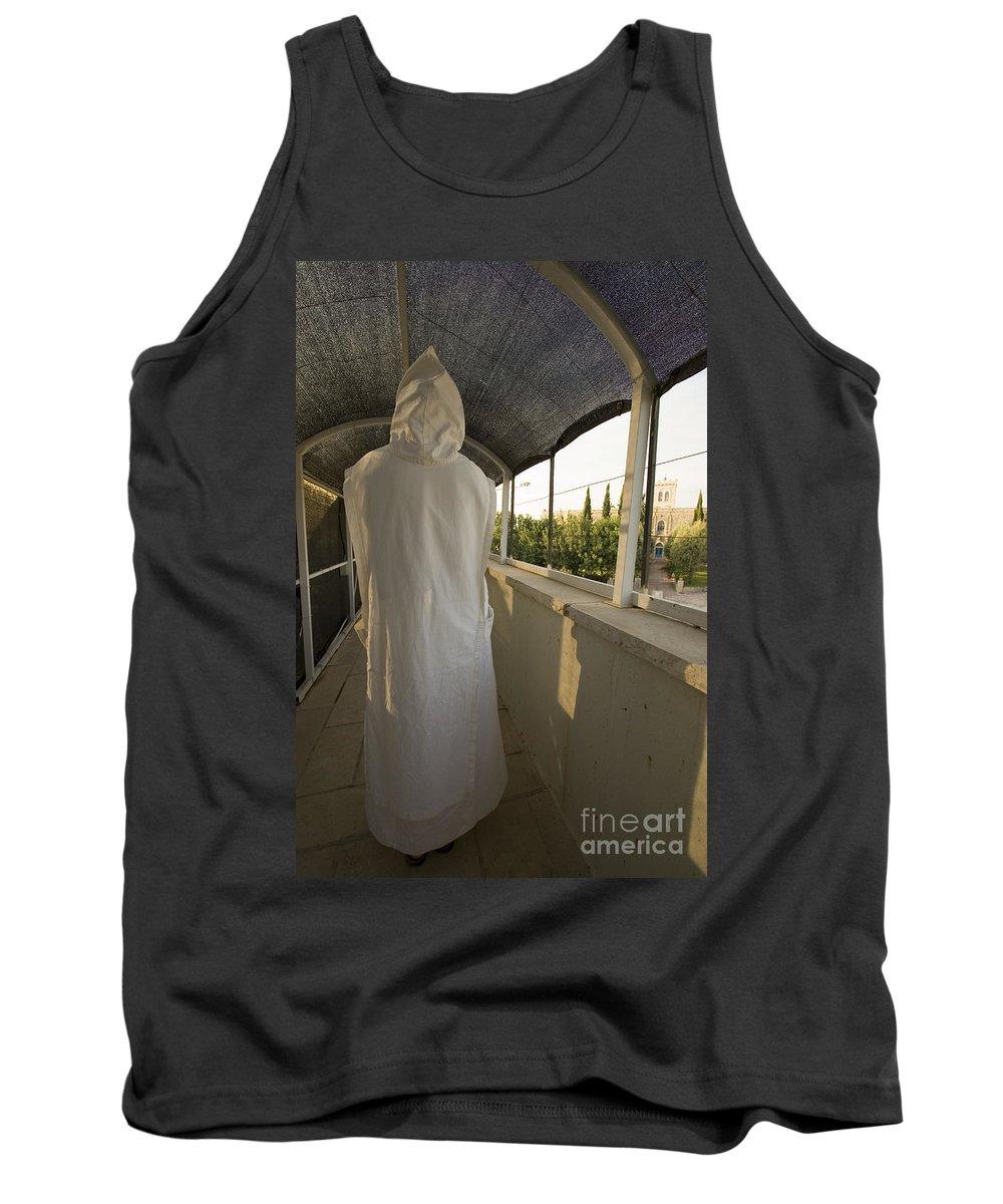 Nun Tank Top featuring the photograph A Nun In A Monastery by Danny Yanai