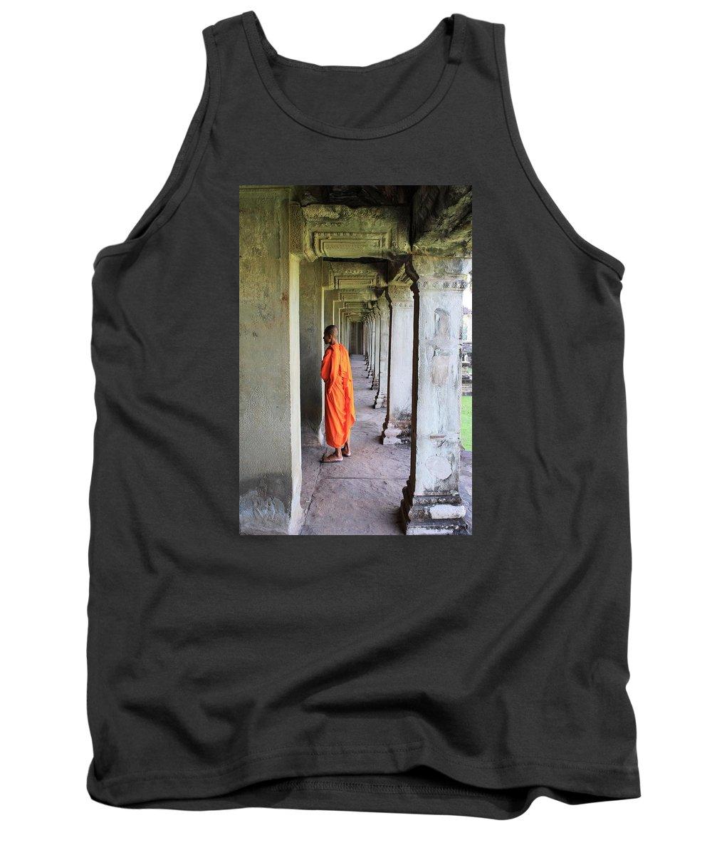 Pillars Tank Top featuring the photograph Monk Among The Ruins At Angkor Wat, Cambodia by John Cumbow
