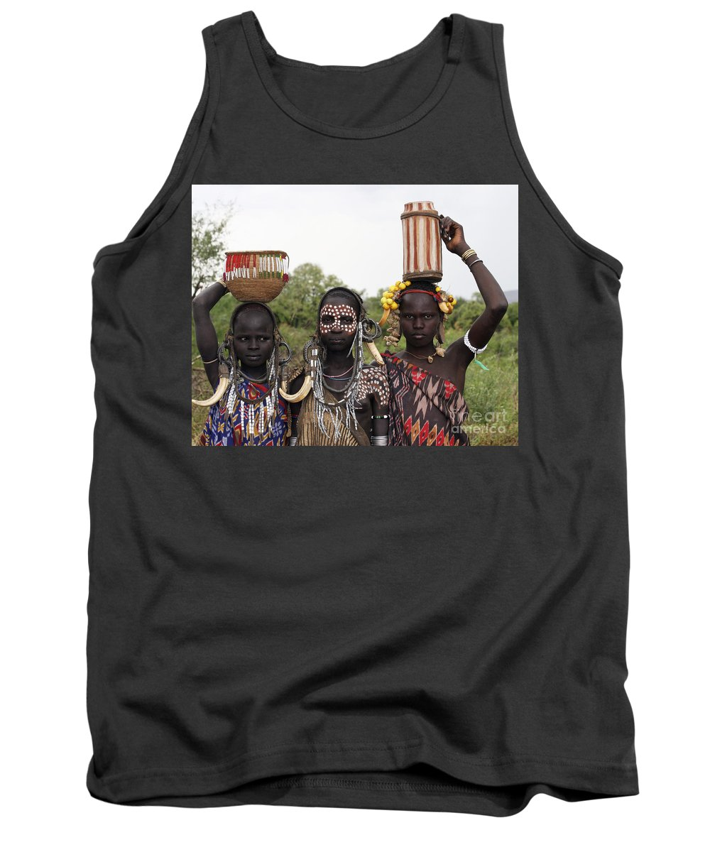 Ethiopia Tank Top featuring the photograph Mursi Tribesmen In Ethiopia by Gilad Flesch