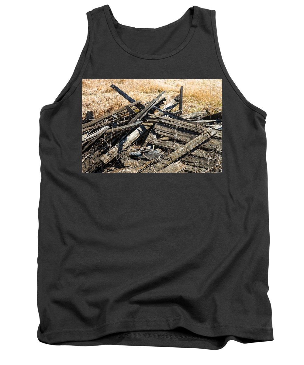 Grain Elevator Tank Top featuring the photograph Pile Of Old Wood by Donald Erickson