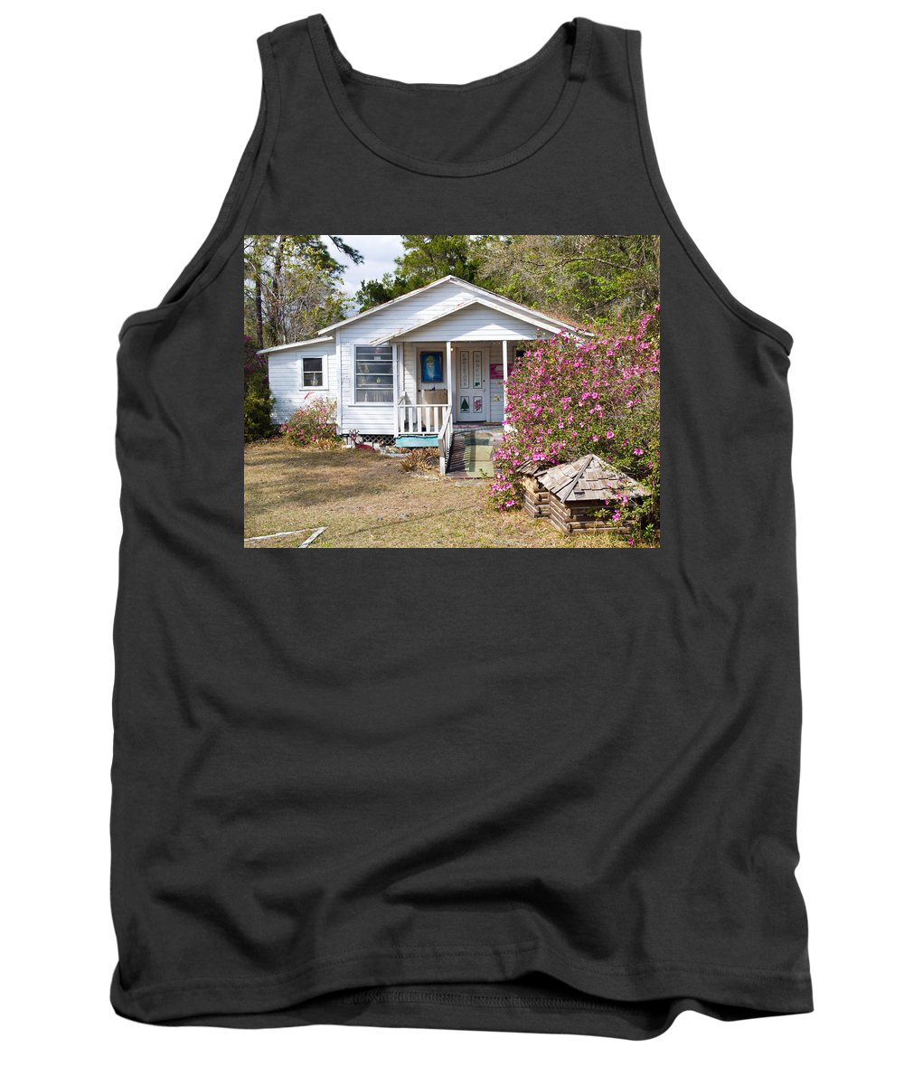 Cabin Tank Top featuring the photograph Santa And Mrs Claus Spend The Spring Months Relaxing by Allan Hughes