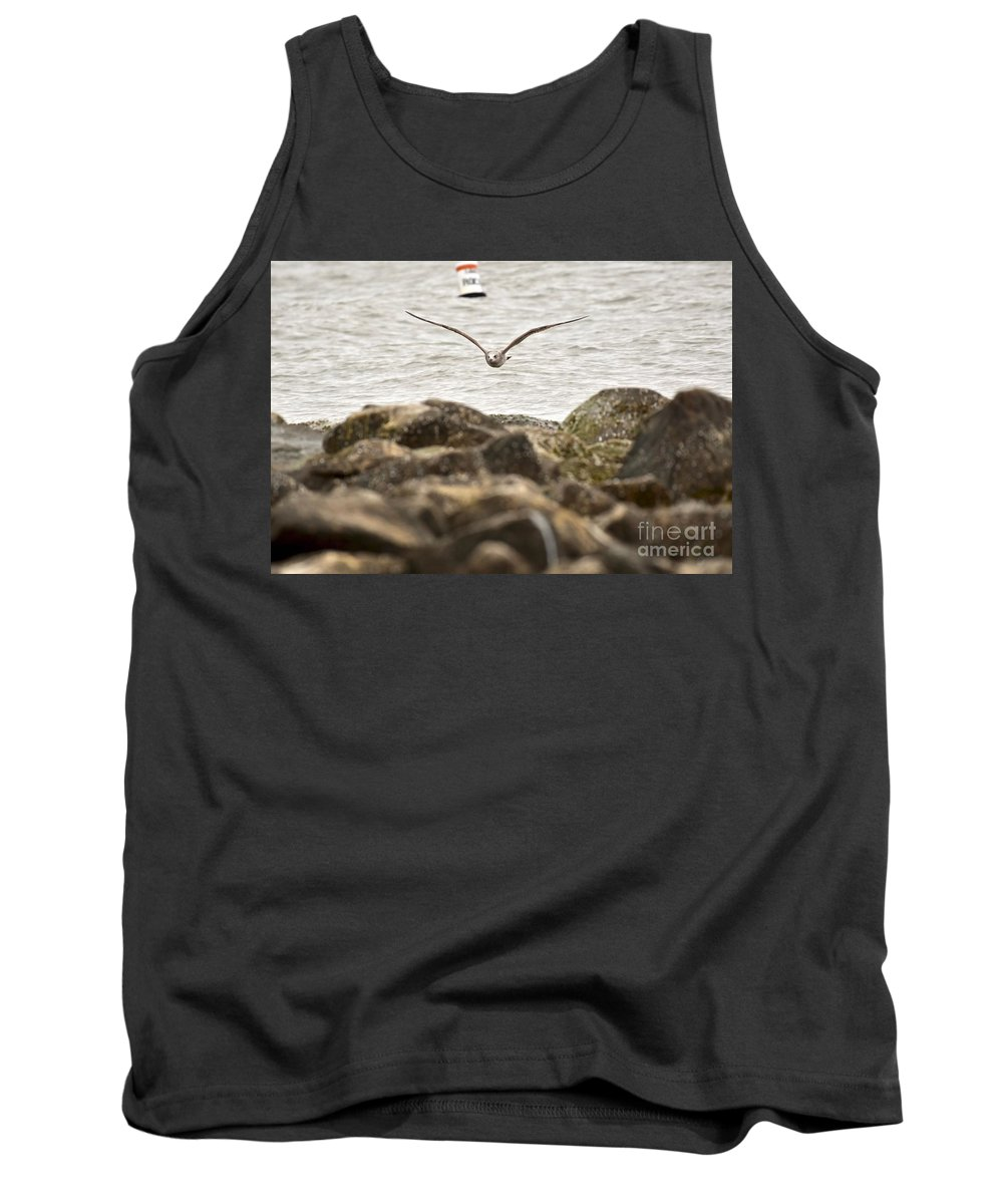 Animal Behavior Tank Top featuring the photograph Seagull Flying Into Ocean Jetty by Jeramey Lende