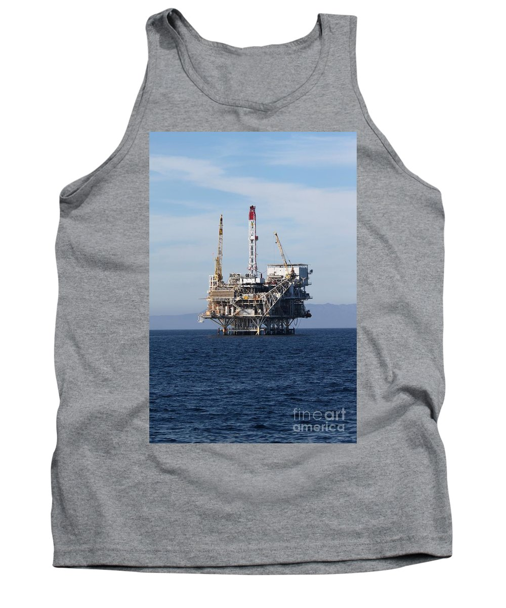 Oil Tank Top featuring the photograph Oil Rig by Henrik Lehnerer