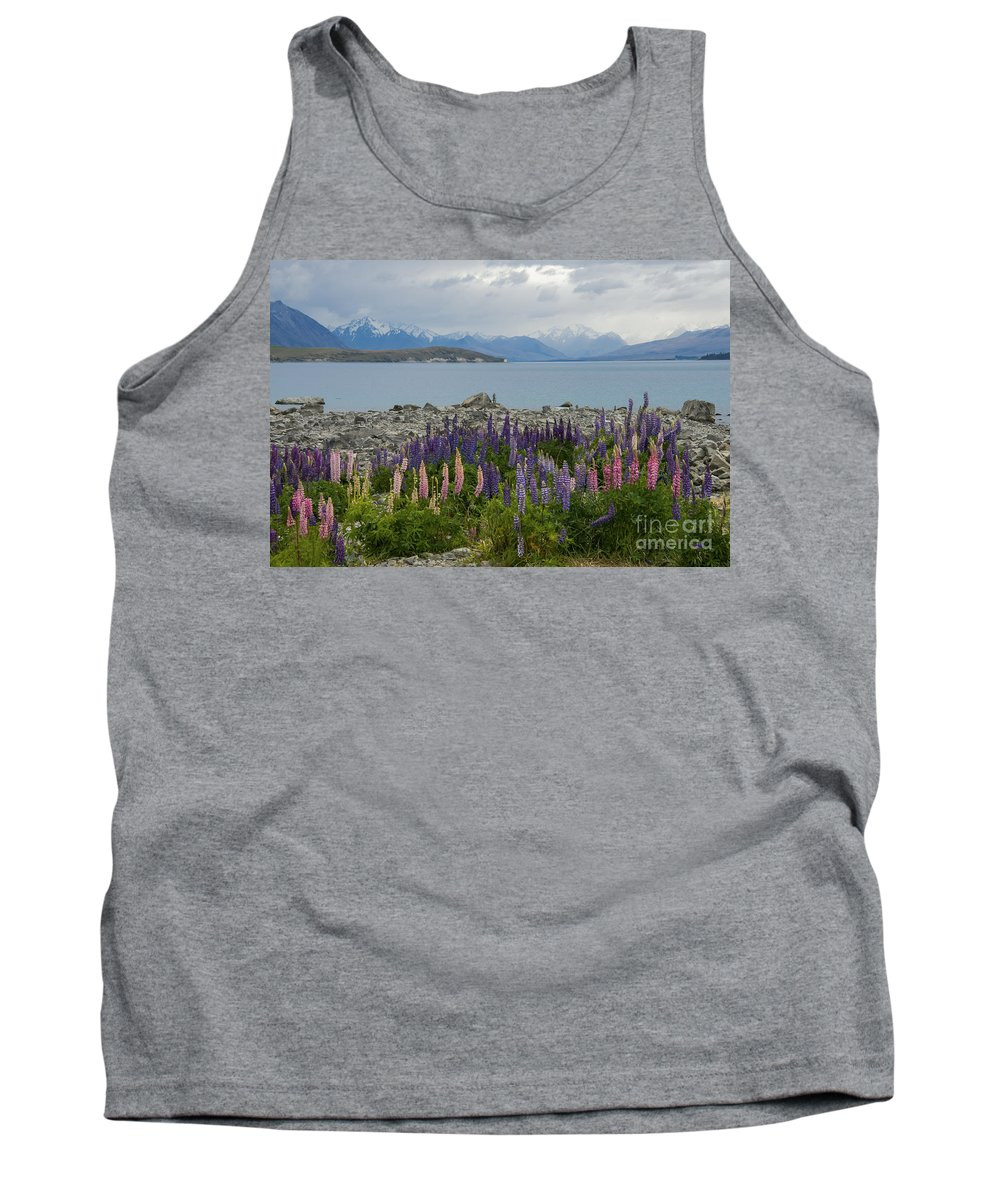 Lake Tekapo New Zealand Rock Rocks Mountain Mountains Lakes Lupin Lupins Flower Flowers Bloom Blooms Plant Plants Landscape Landscape Waterscape Waterscapes Mt. Mount Cook Tank Top featuring the photograph Lupins By The Lake by Bob Phillips