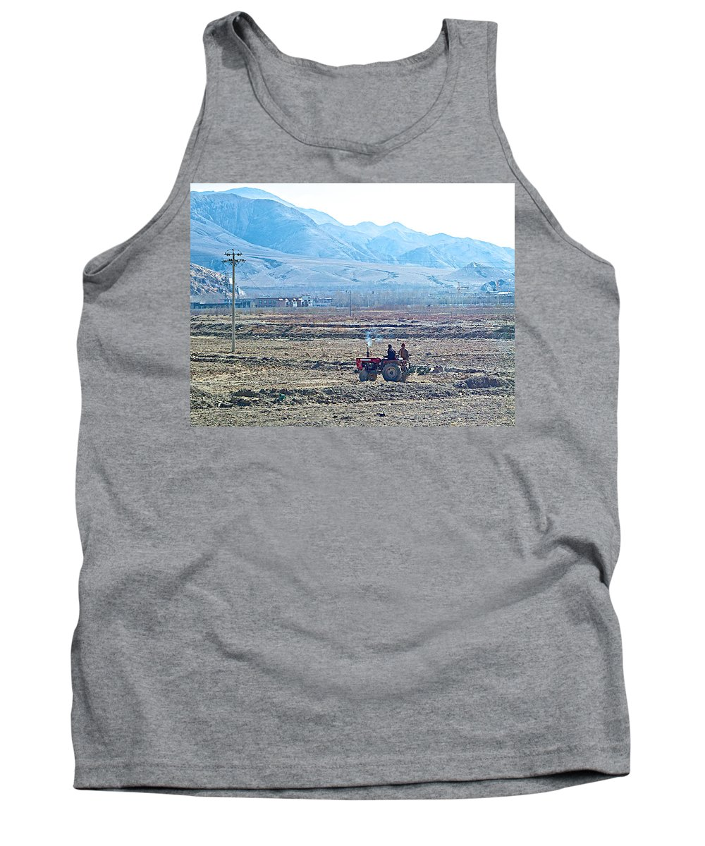 Tractor Used In Farming Along The Road To Shigatse Tank Top featuring the photograph Tractor Used In Farming Along The Road To Shigatse-tibet by Ruth Hager