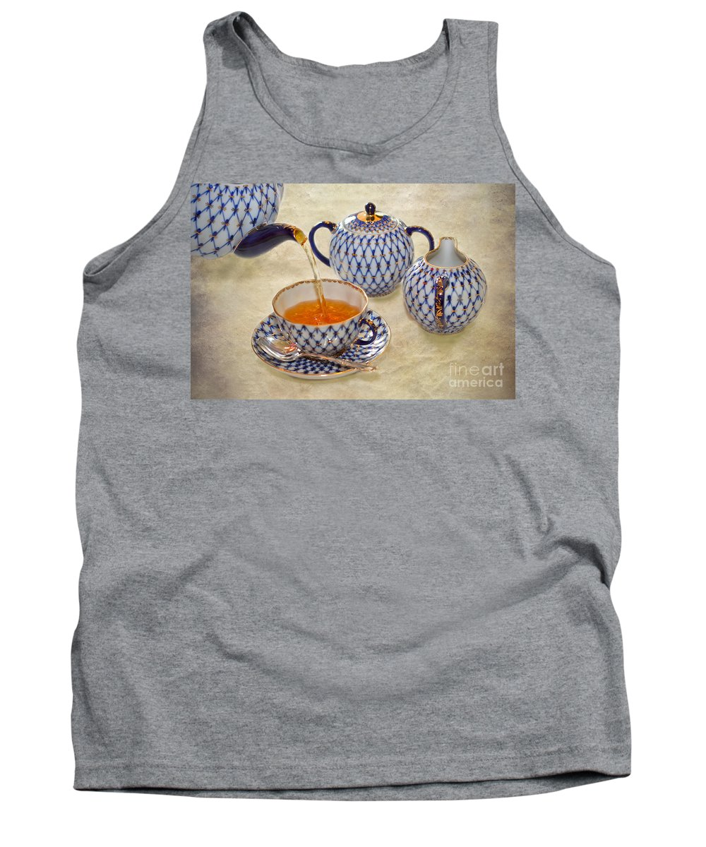 Tea Tank Top featuring the photograph A Cup Of Tea Tea Being Poured Into A China Cup by Louise Heusinkveld