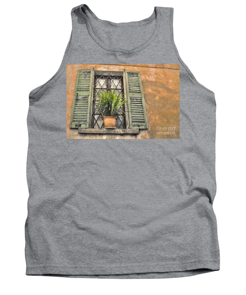 Window Tank Top featuring the photograph Old Window And A Green Plant by Mats Silvan