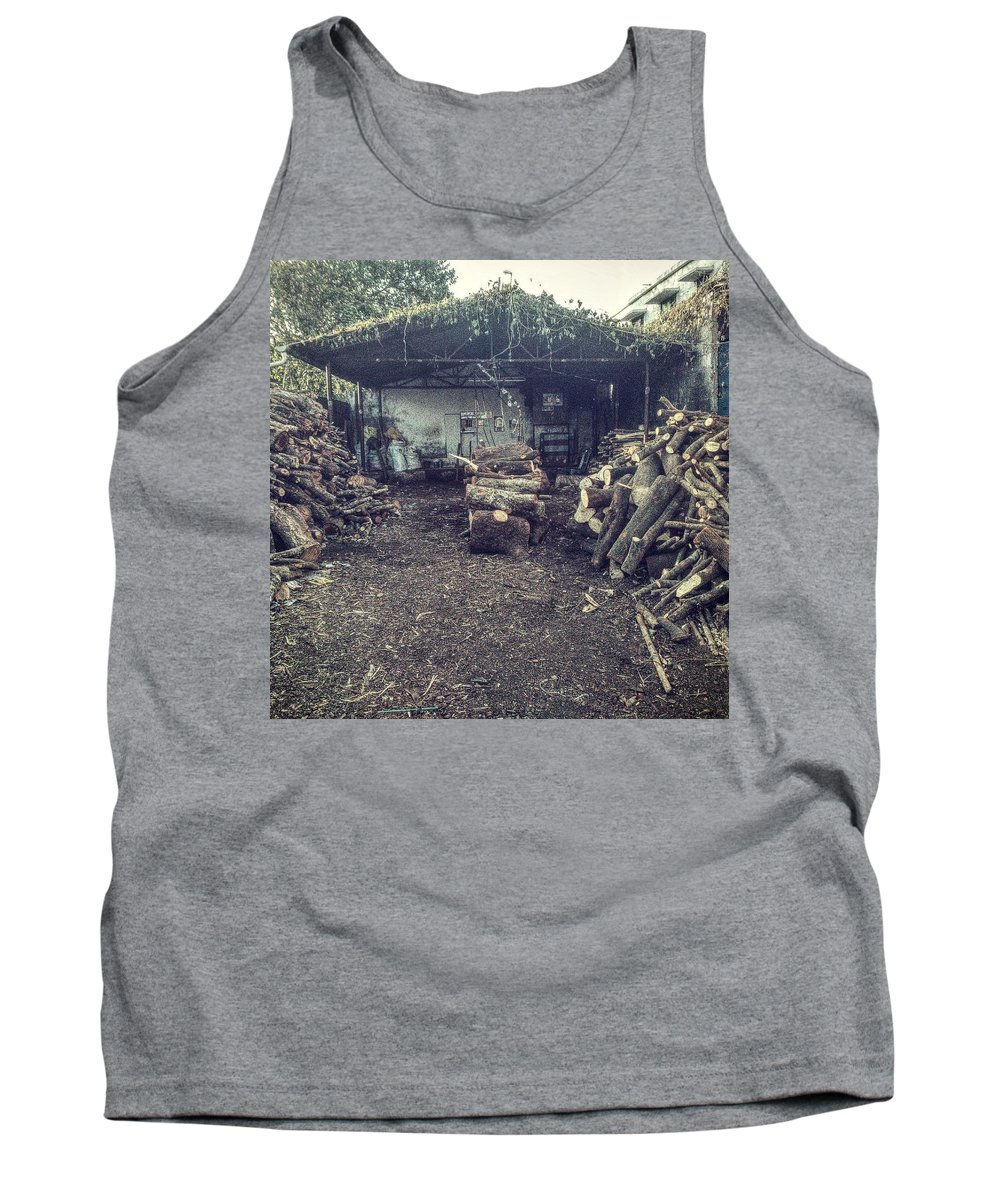 Firewood Tank Top featuring the photograph Firewood Shoppe by Mubarak Atmata