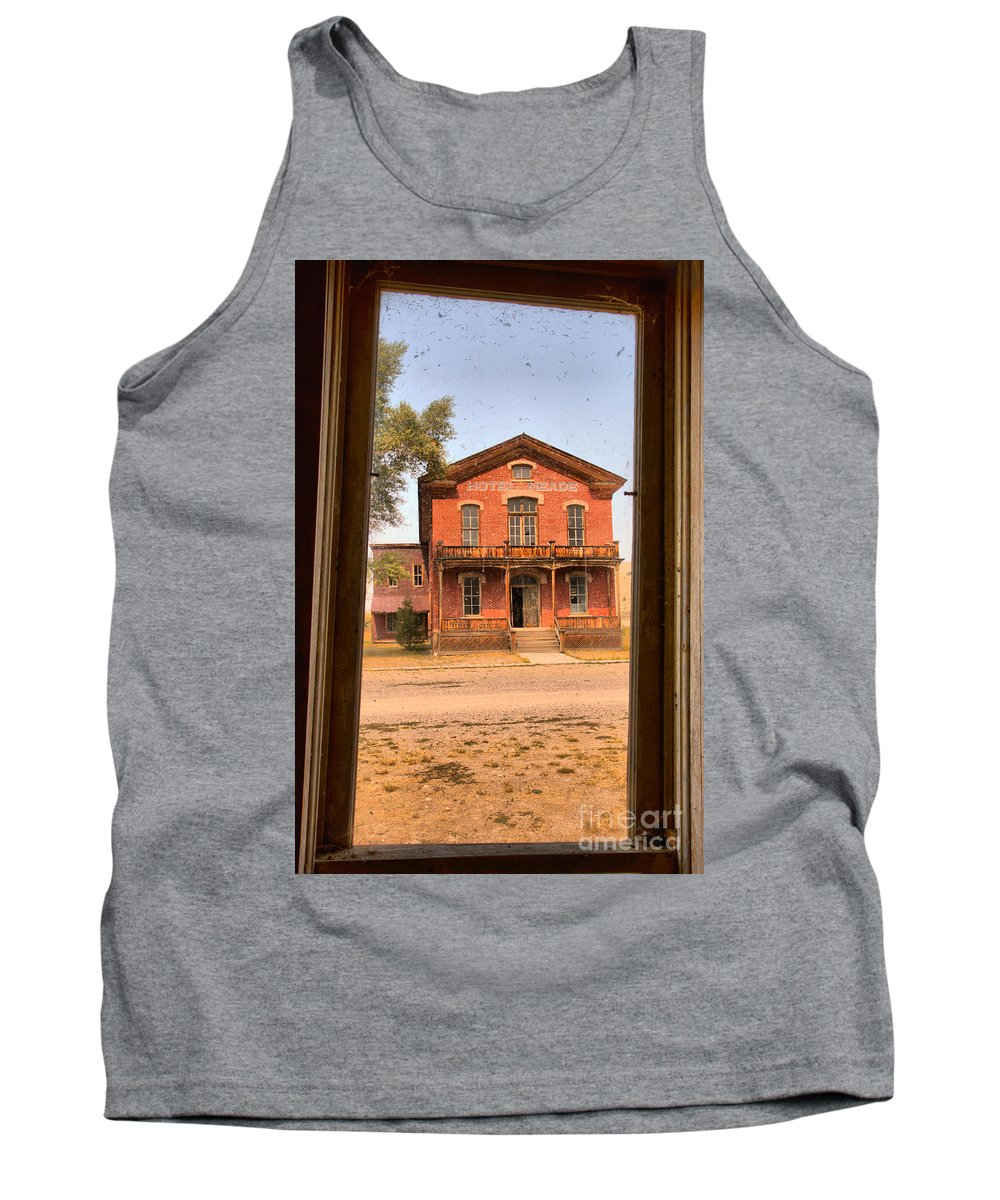 The Historic Meade Hotel In The Montana Ghost Town Of Bannack Is Framed By A Crooked Window Frame In A Building Across The Street. Tank Top featuring the photograph Meade Hotel Framed by Adam Jewell