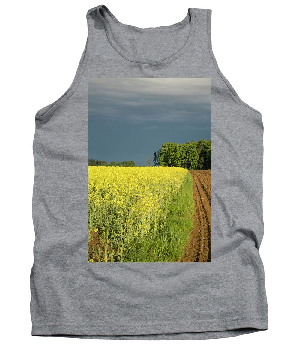 Brnik Tank Top featuring the photograph Rapeseed Field With Storm Clouds In Background by Ian Middleton