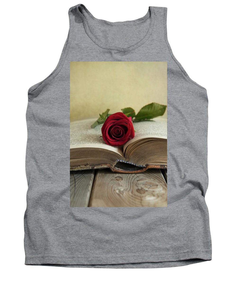 Book Tank Top featuring the photograph Red Rose On An Old Big Book by Jaroslaw Blaminsky