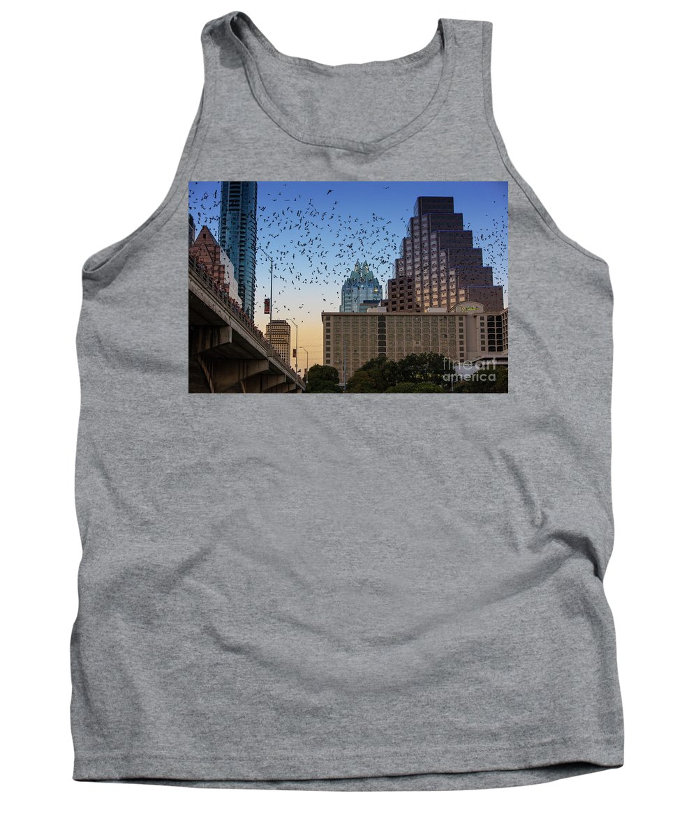 Austin Bats Hotline Tank Top featuring the photograph The Frost Bank Tower Stands Guard As 1.5 Million Mexican Free-tail Bats Overtake The Austin Skyline As They Exit The Congress Avenue Bridge by Austin Welcome Center
