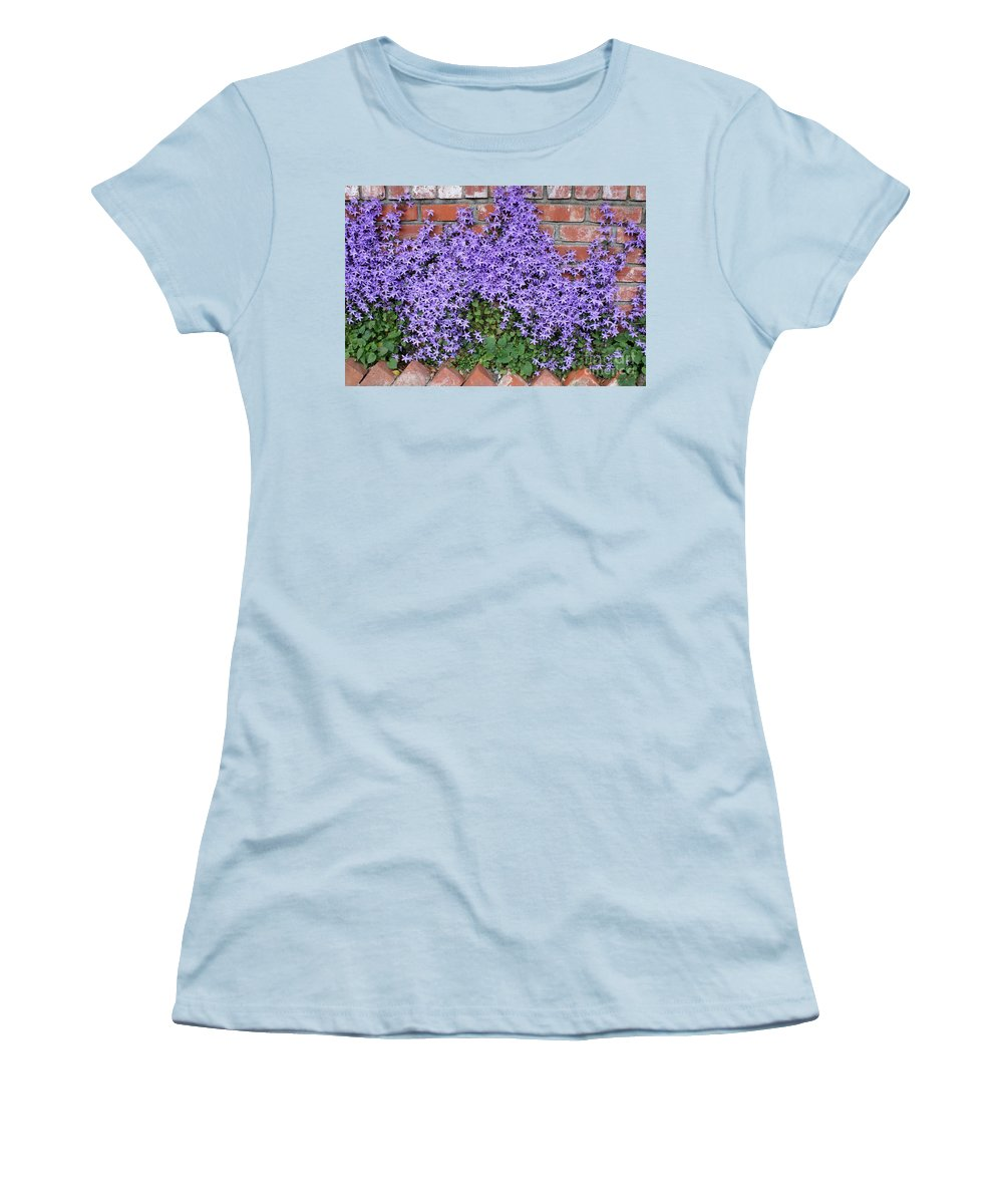 Blue Flowers Women's T-Shirt (Athletic Fit) featuring the photograph Brick Wall With Blue Flowers by Carol Groenen