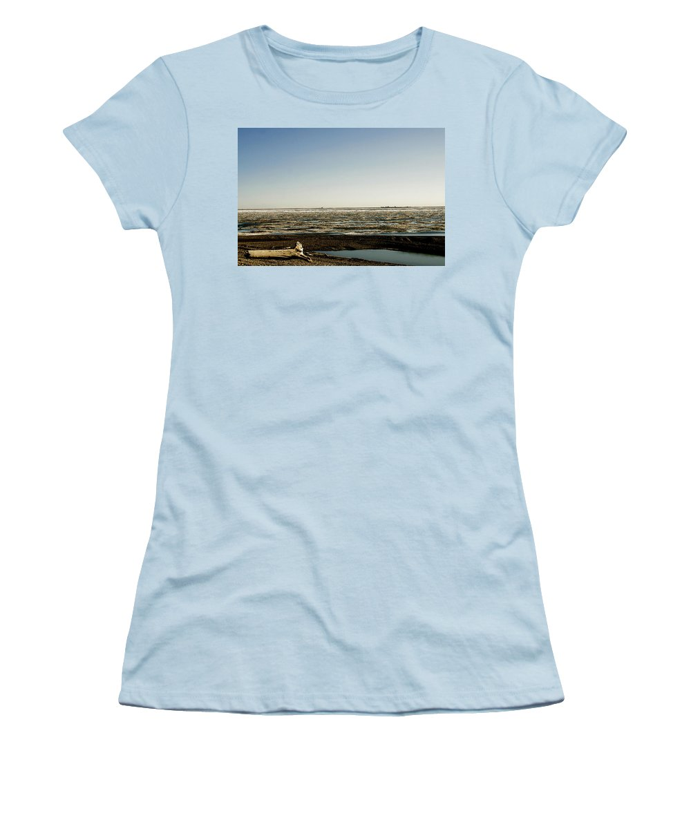 Driftwood Women's T-Shirt (Athletic Fit) featuring the photograph Driftwood On Arctic Beach by Anthony Jones