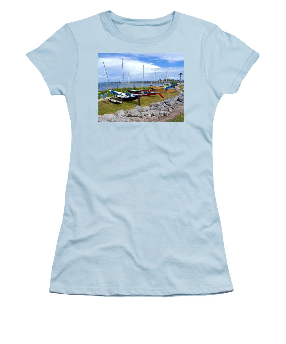 Sail; Sailing; Boat; Sailboat; Mast; Plywood; Homemade; Boy; Scouts; Fleet; Class; Dragon; Tiller; F Women's T-Shirt (Athletic Fit) featuring the photograph Homemade Outriggers Canoes On The Indian River Lagoon In Florida by Allan Hughes