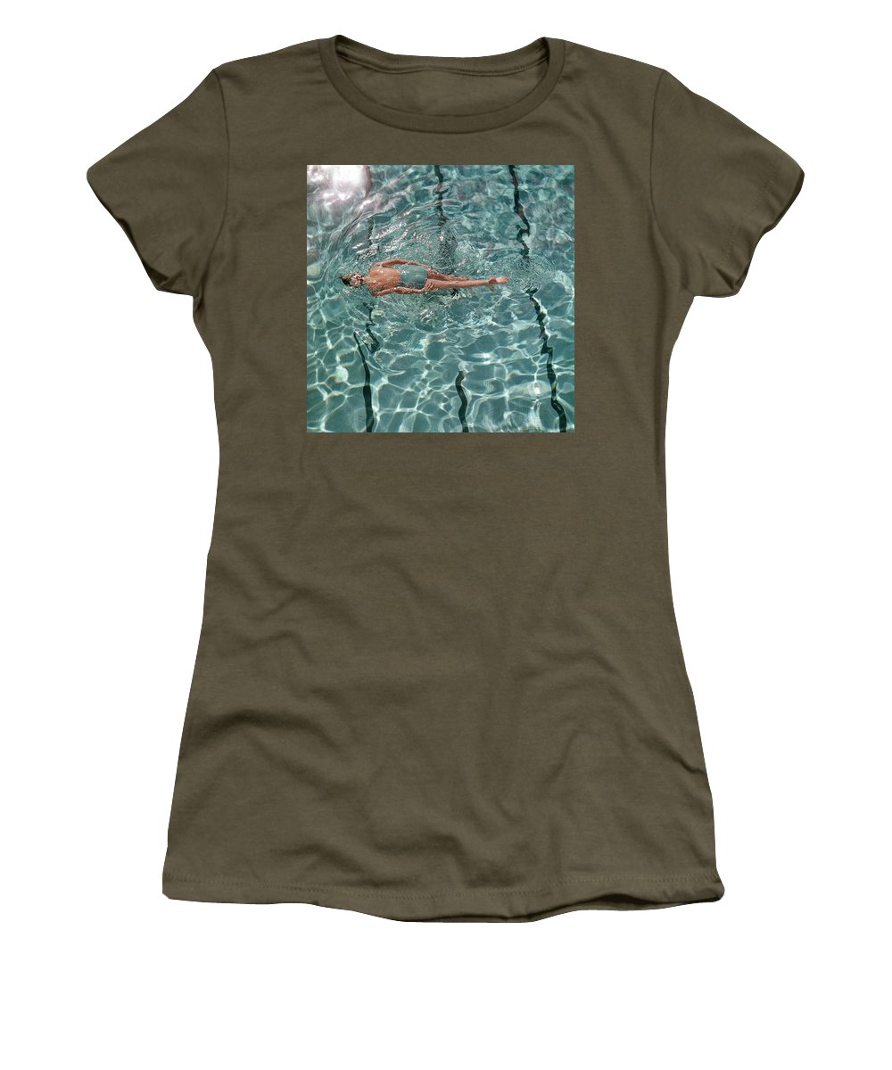Water Women's T-Shirt featuring the photograph A Woman Swimming In A Pool by Fred Lyon