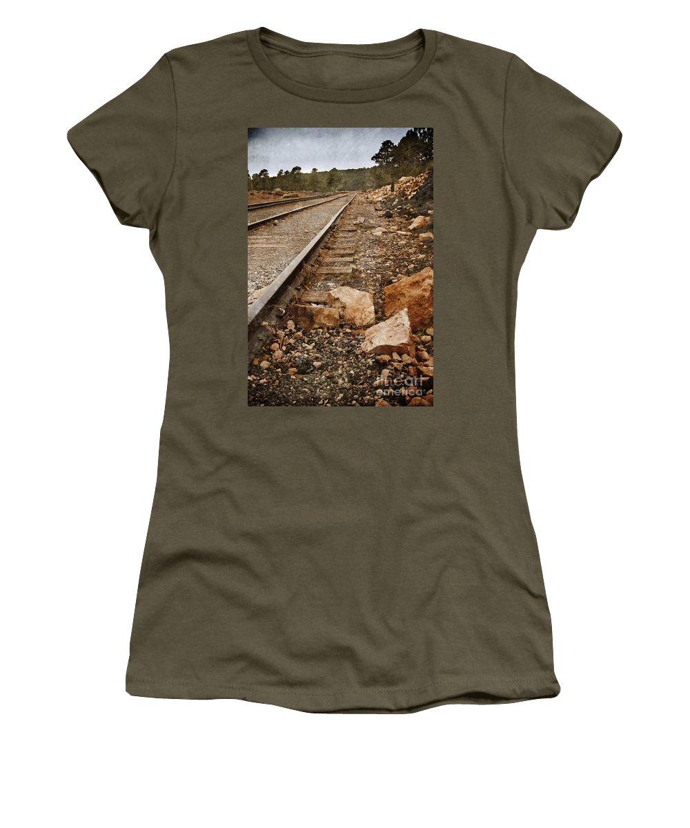 Rail; Railroad; Tracks; Train Tracks; Barren; Empty; Rocks; No One; Trees; Arizona; Ominous; Metal; Line; Iron; Ties; Gravel; Transportation; Stone; Pebbles; Rural; Vanishing Point; Outside Women's T-Shirt featuring the photograph Along The Tracks by Margie Hurwich