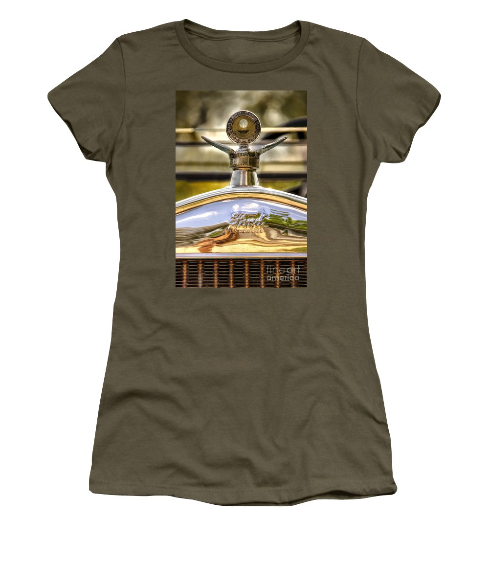 Ford; Car; Detail; Ornament; Hood; Chrome; Auto; Automobile; Transportation; Decor; Rust; Reflection; Close Up; Model T; 1920s; Vintage; Shiny; Glare; Antique; Turn Of The Century; Early 1900s; 20s; Vehicle Women's T-Shirt featuring the photograph Model T by Margie Hurwich