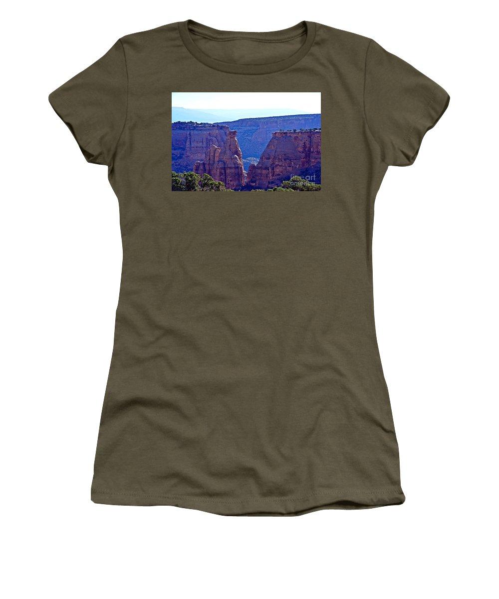 Rim Rock Women's T-Shirt (Athletic Fit) featuring the photograph Rim Rock Colorado by Randy J Heath