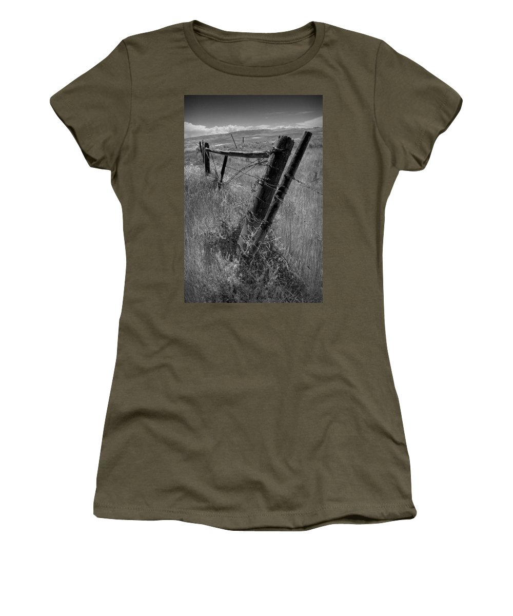 Art Women's T-Shirt featuring the photograph Fence Posts And Barbed Wire At The Edge Of A Field In Montana by Randall Nyhof