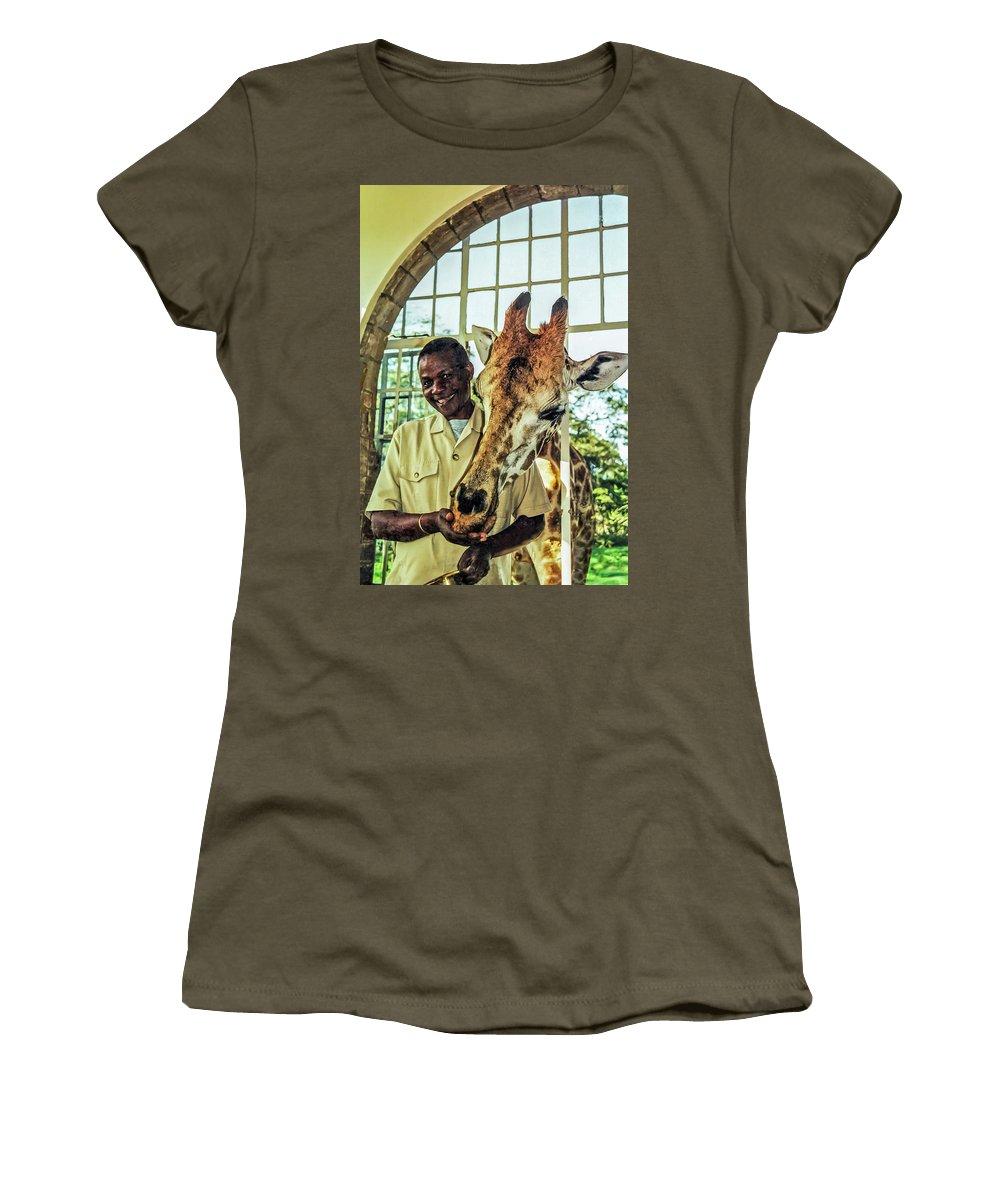 Rothchild's Giraffe Women's T-Shirt featuring the photograph A Rothchild's Giraffe Munching Horse Pellets Through An Open Window by Elizabeth Hershkowitz