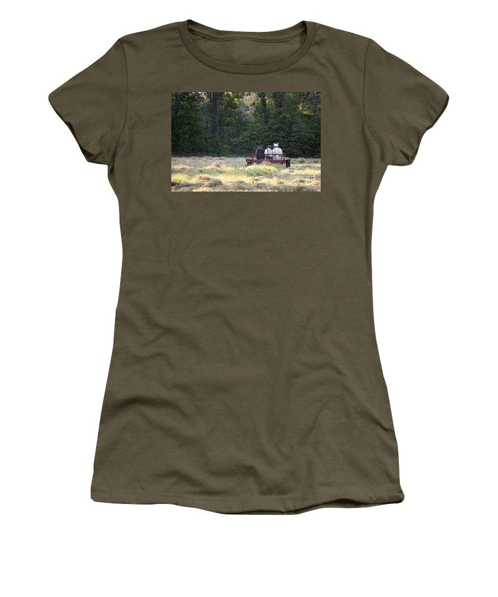 Amish Women's T-Shirt featuring the photograph Amish Farmer Raking Hay At Dusk by David Arment
