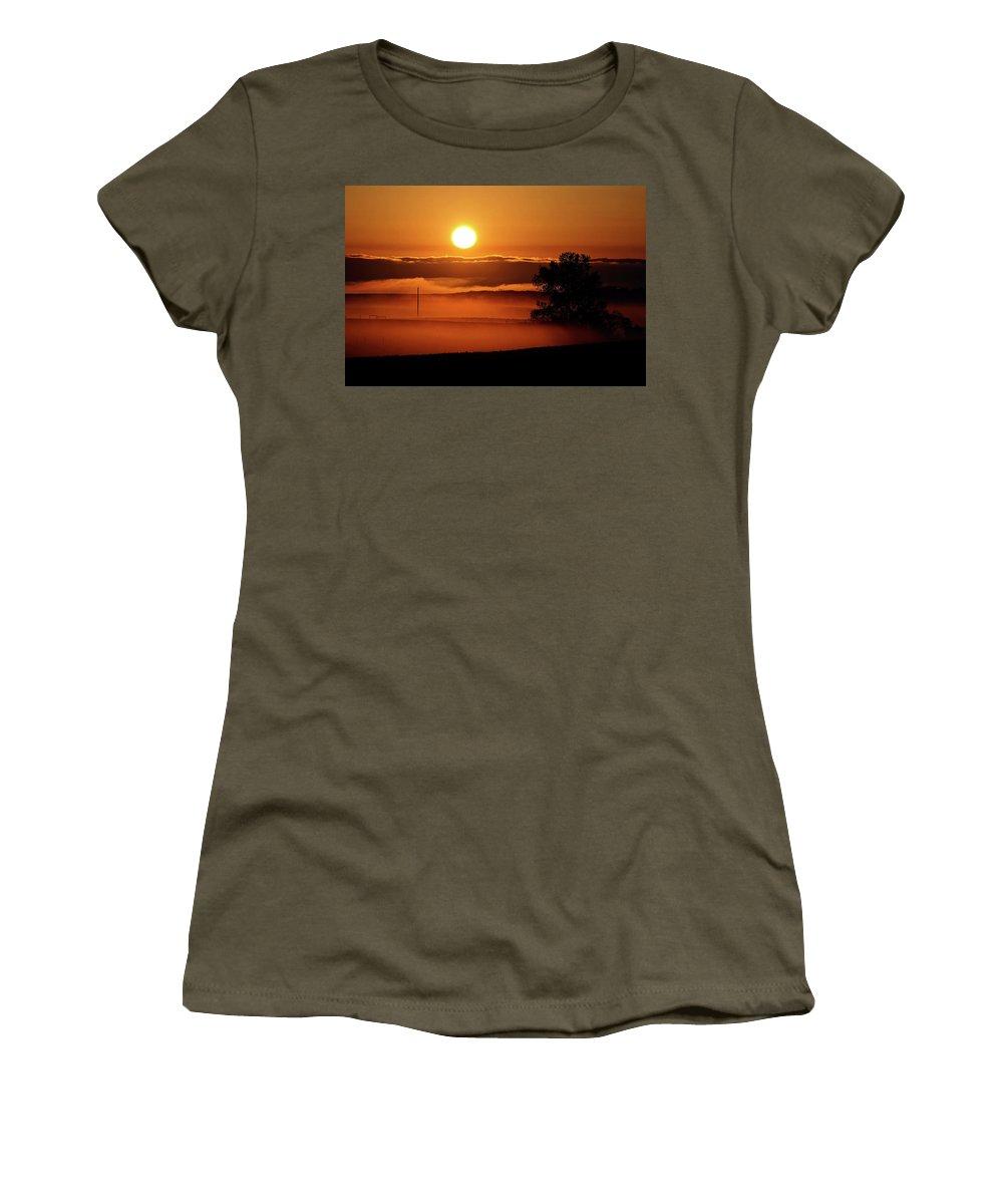 Women's T-Shirt featuring the digital art Rising Sun Lighting Ground Fog by Mark Duffy