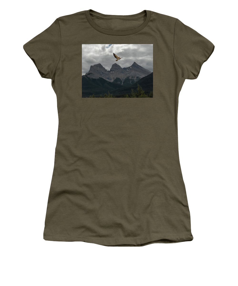 Hawk Mountains Trees Woods Banff Alberta Wild Bird Hunter Flying Three Sisters Women's T-Shirt featuring the photograph The Calling by Andrea Lawrence