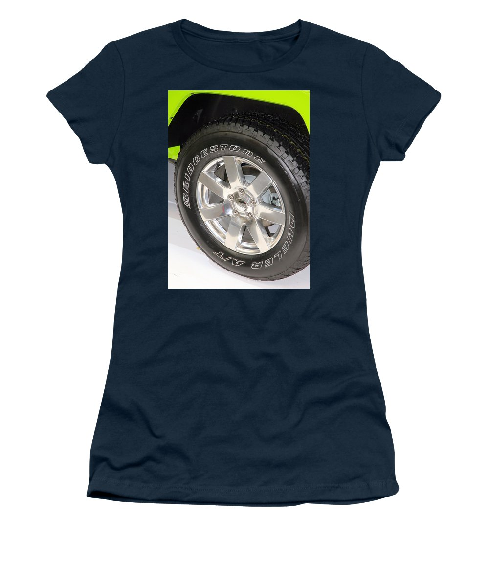 Wheel Women's T-Shirt featuring the photograph Bridgestone Tire by Valentino Visentini