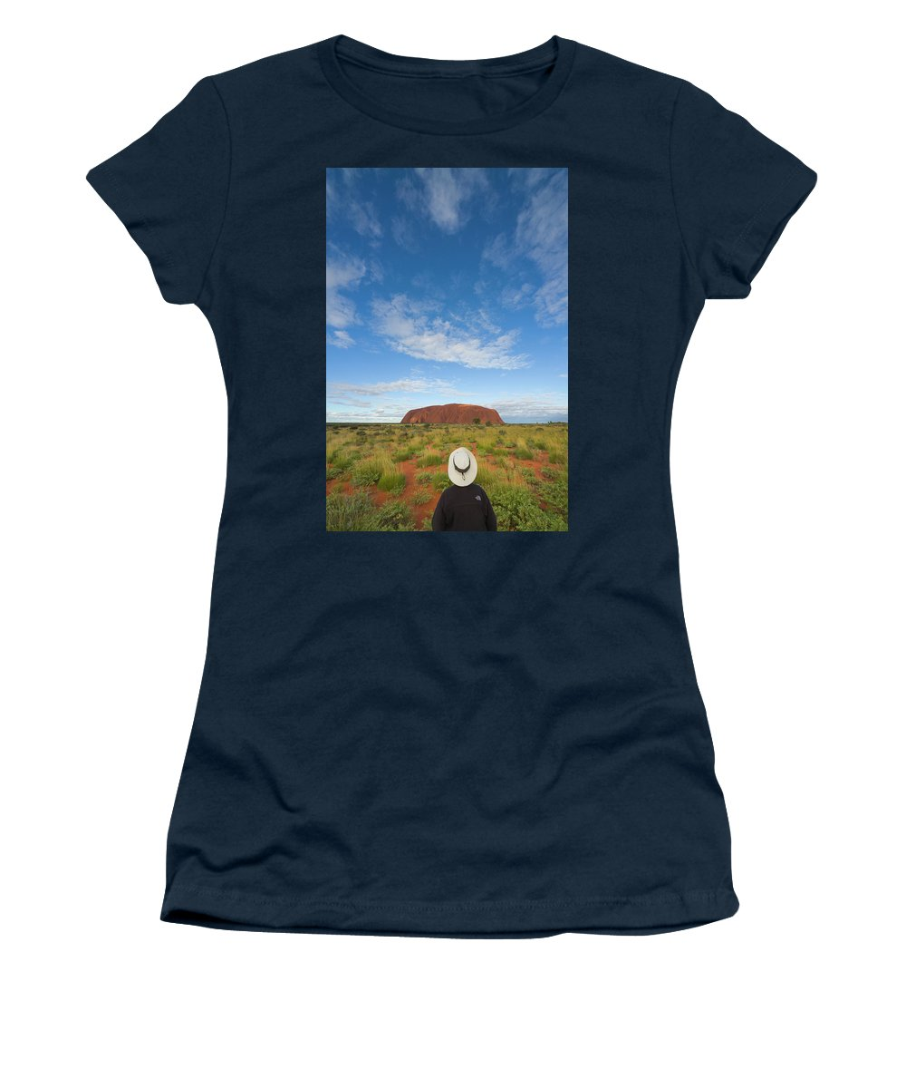00477467 Women's T-Shirt featuring the photograph Tourist And Clouds At Ayers Rock by Yva Momatiuk John Eastcott
