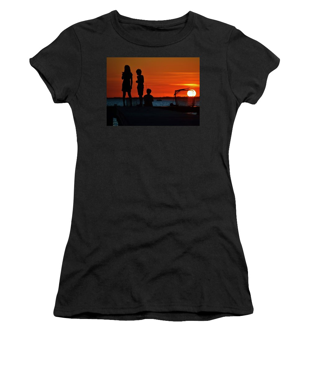 Beach Bum Pics Women's T-Shirt featuring the photograph Perfect Ending - 3 Friends On A Pier As The Hot Summer Sun Sets On The Indian River Bay by William Bartholomew