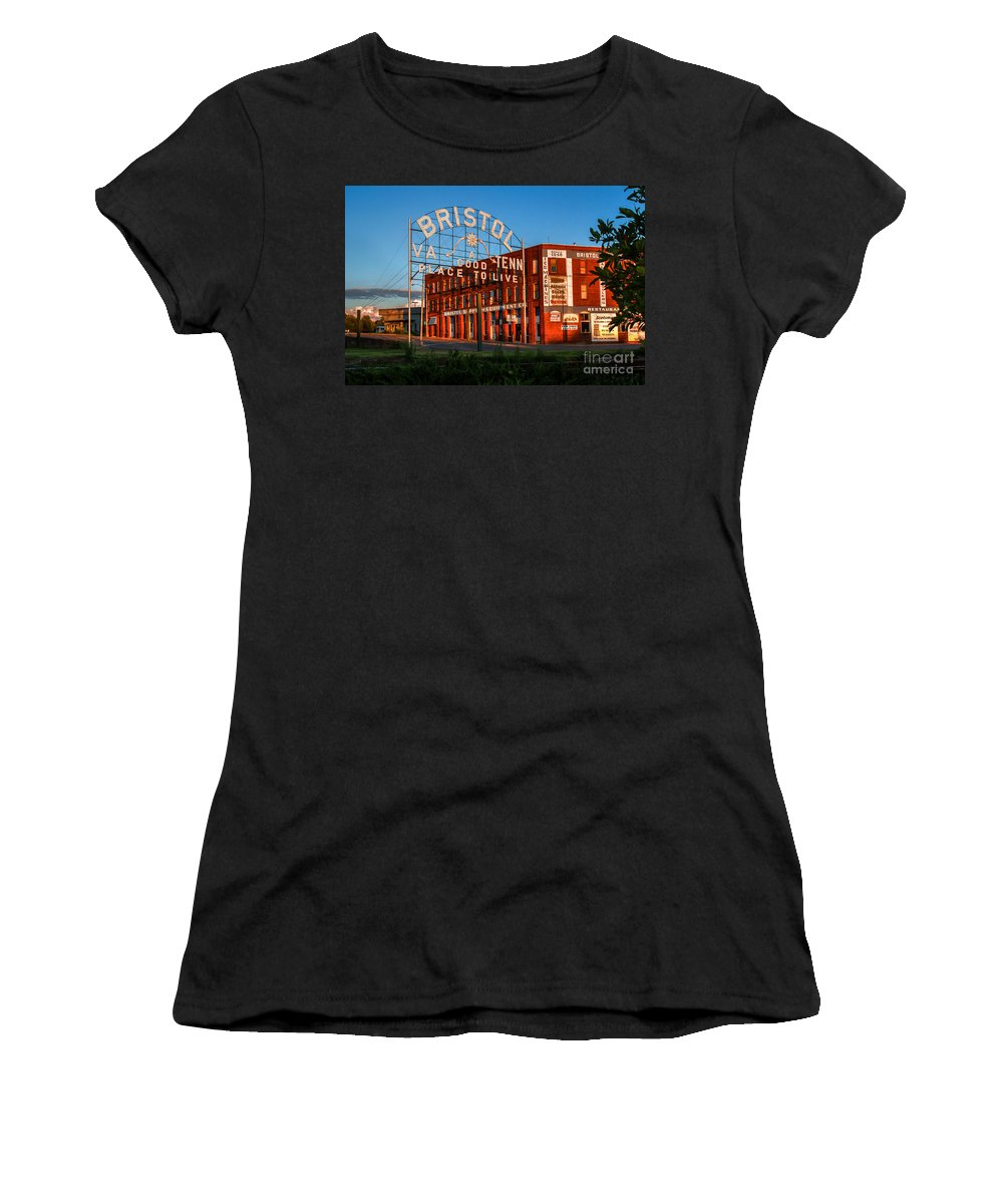 Bristol Tn Tennessee Va Virginia Train Tracks Dusk Historic Sign State Street Interstate Hardware Company Golden Hour Sunset Women's T-Shirt (Athletic Fit) featuring the photograph A Good Place To Live 2 by Karl Greeson