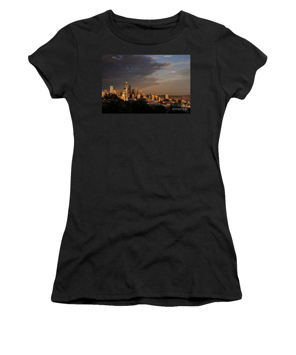 Kerry Park Women's T-Shirt featuring the photograph Seattle Skyline With Space Needle And Stormy Weather With Mount by Jim Corwin
