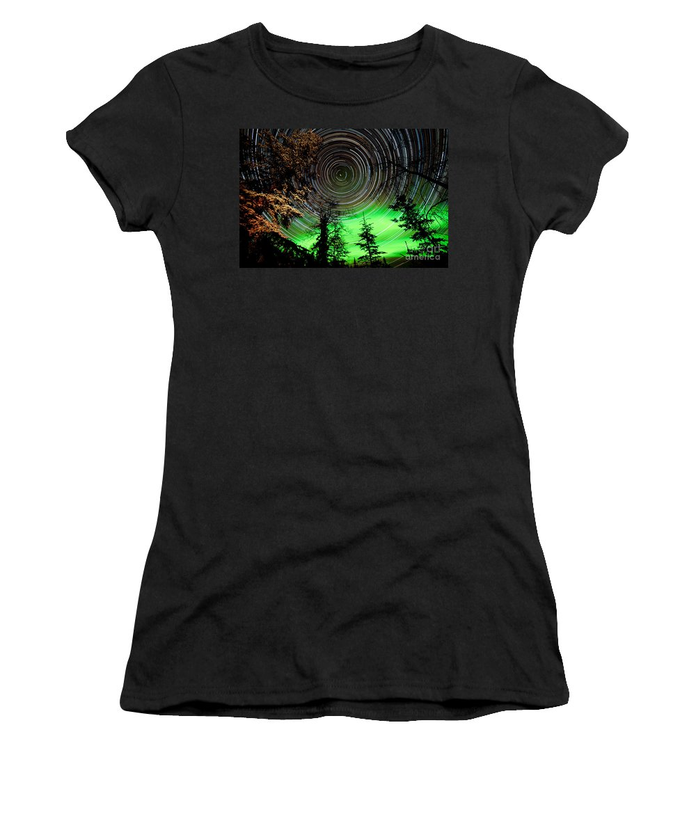 Astro Women's T-Shirt (Athletic Fit) featuring the photograph Star Trails And Northern Lights In Sky Over Taiga by Stephan Pietzko